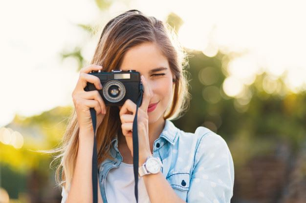 girl-taking-photos-with-vintage-camera-sunny-day_158595-1336